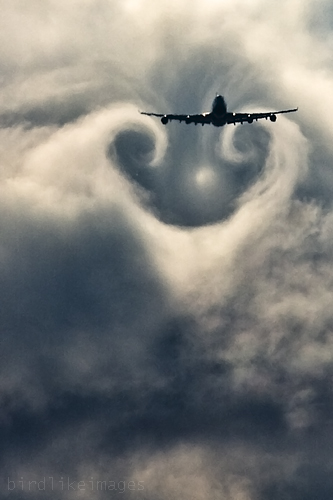 Commercial airplane and wake turbulence.