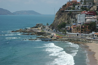 Details of the south coast of Mazatlan, from 10 stories up, rich hill, interesting architecture, public salt water swimming pool,  domes, edge of the gold sands, street, Pacific waves, mountains, South Mazatlan, Sinaloa, Mexico