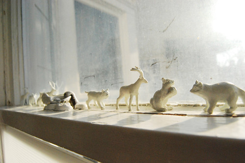 White painted plastic animals