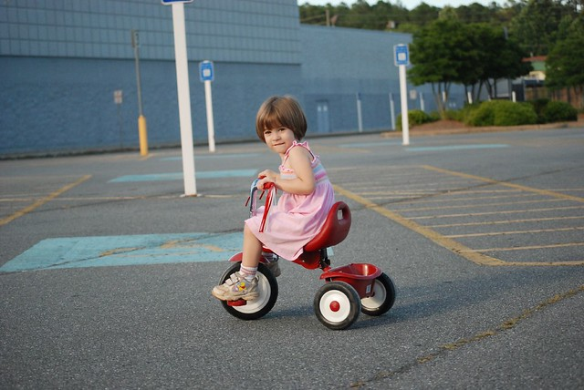 a little girl and her red trike!