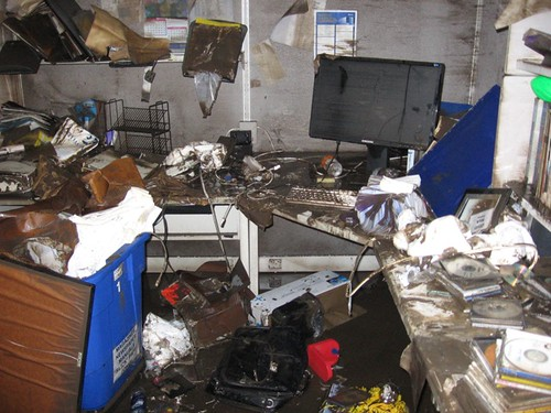 Office with flood damage: computers and files destroyed
