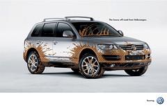 model car(0.0), executive car(0.0), saab 9-4x(0.0), automobile(1.0), automotive exterior(1.0), sport utility vehicle(1.0), wheel(1.0), vehicle(1.0), compact sport utility vehicle(1.0), volkswagen touareg(1.0), bumper(1.0), land vehicle(1.0), luxury vehicle(1.0),
