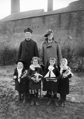A Belgian priest and an Australian padre with some village children