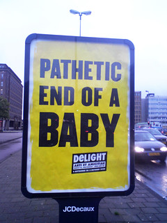 poster in the city of Amsterdam: PATHETIC END OF A BABY