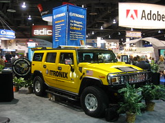 off-roading(0.0), automobile(1.0), automotive exterior(1.0), sport utility vehicle(1.0), vehicle(1.0), hummer h3(1.0), hummer h2(1.0), hummer h3t(1.0), off-road vehicle(1.0), land vehicle(1.0), luxury vehicle(1.0), motor vehicle(1.0),