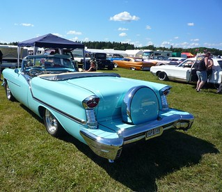 1957 Blue Convertible Oldsmobile with continental kit