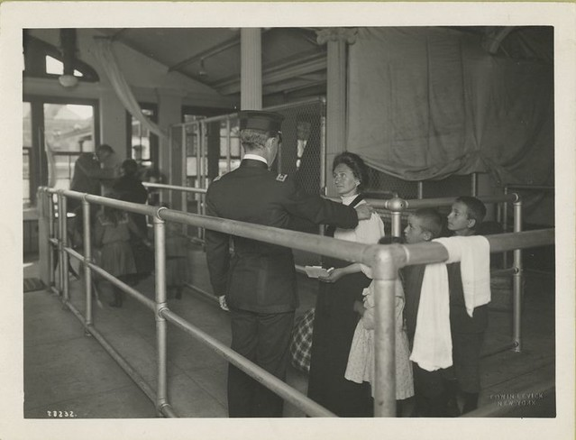 Immigrants undergoing medical examination.
