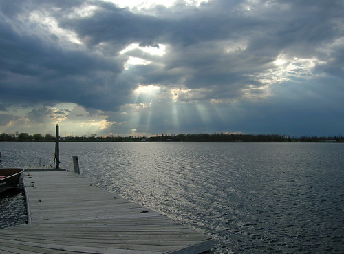 sky sun sunlight lake water minnesota clouds pier dock rays sunrays ranier northernminnesota rainylake unature