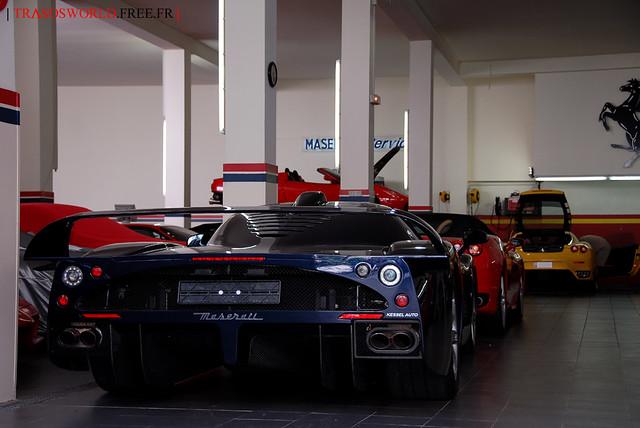 Blue Maserati MC12 at Ferrari garage