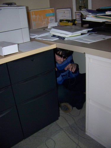 Mystery Assistant Under the Desk