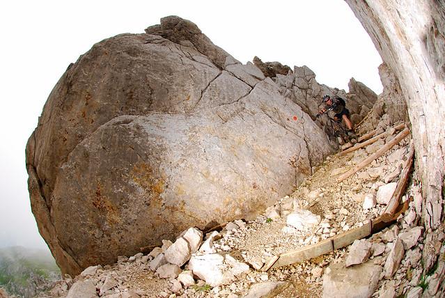 Between the boulders.