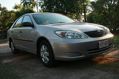 automobile(1.0), automotive exterior(1.0), toyota(1.0), vehicle(1.0), toyota camry(1.0), bumper(1.0), sedan(1.0), land vehicle(1.0),