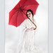 The Lady in White With a Red Umbrella