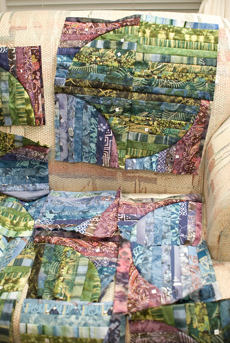 I have about 75% of the squares created, but I realized I needed a bit of gratification, so I sewed two sets of the squares together to get a better feel for what the finished quilt might look like.