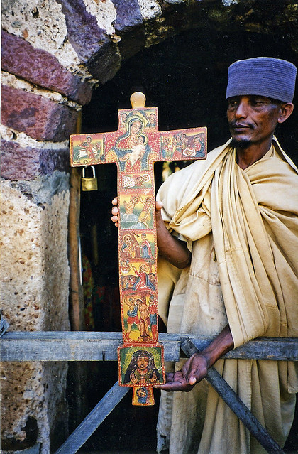 Abbot with Cross bearing Christian images, Ancient African monistary, Lake Tana, Ethiopia