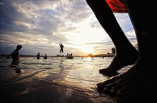 sunset india feet water silhouette evening jump nikon winner nikkor d3 haryana kurukshetra 1424mm solareclipsefair epsoncolorimagingcontest2008