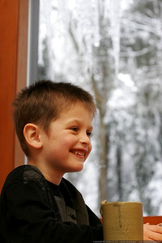nick, watching his little brother make a big mess with a little cup of hot chocolate     MG 4189