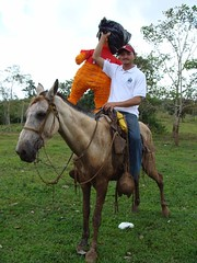 DSC02885 Fadir taking the piñata on horseback up to the ribbon-cutting ceremony at Okawas
