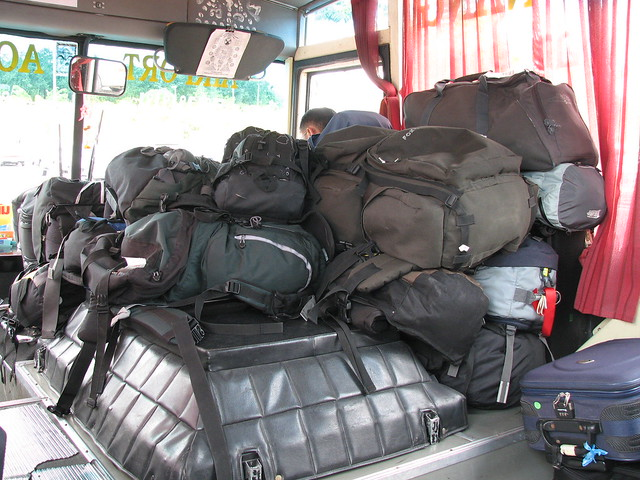 Backpacks  on the bus by flickr user decidida