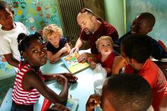 Rodney and his kids having fun in the Bella Vista homework room.