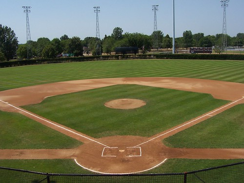 park cold green beautiful grass minnesota fence spring baseball box ivy dirt springer paths lightpoles mound press amateur scoreboard patterned springers crosscut mowed chalked watered battersbox baselines