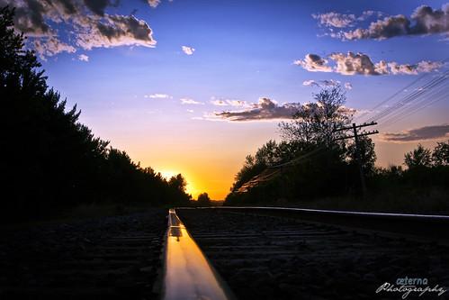 railroad sunset train tracks rail rails distance vanish