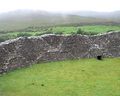building(0.0), soil(0.0), megalith(0.0), ruins(0.0), wall(1.0), mound(1.0), hill(1.0), bedrock(1.0), plateau(1.0), terrain(1.0), rock(1.0),