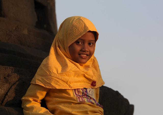 Veiled young girl at sunset, Borobudur, Java, Indonesia