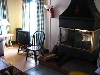 Living room fireplace at Riverside Inn