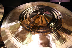 wheel(0.0), drums(0.0), compact disc(0.0), gramophone record(0.0), aircraft engine(0.0), eye(0.0), close-up(1.0), cymbal(1.0),