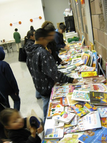 young people looking at gift books
