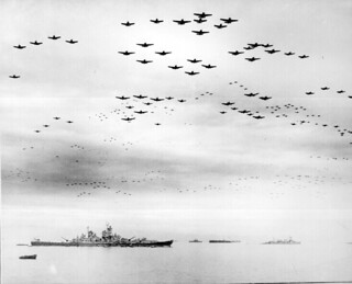 F4Us and F6Fs fly in formation during surrender ceremonies