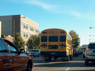 Southbound school bus on North western Avenue during the late afternoon rush hour. Chicago Illinois. October 2007. by Eddie from Chicago