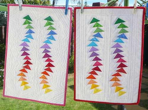 Two wonky flying geese dolls quilts.