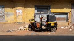 a rickshaw in the sun