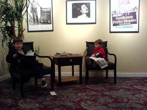 brothers killing time in a movie theater lobby before their film starts   DSC02123