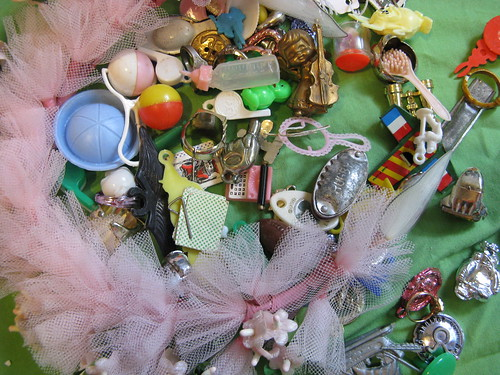 A whole baggie of Cracker Jack toys & charms