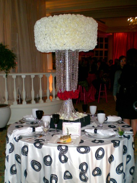 White bling wedding centerpiece White carnations are compacted at the top