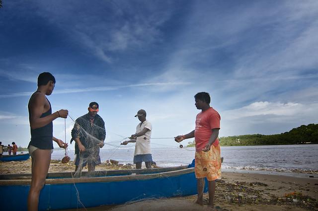 Getting the Fishing Nets Ready. River Mandovi in Panjim, Goa, India.