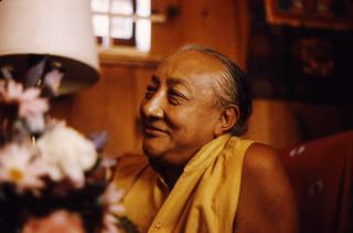 Dilgo Khyentse Rinpoche reflecting with a smile, at the Sakya Center དིལ་མགོ་མཁྱེན་བརྩེ་, Seattle, Washington, USA