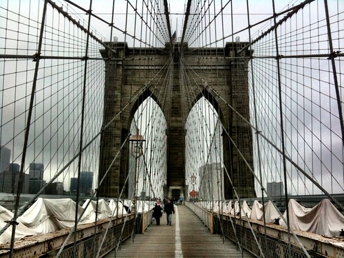 Despite the doom & gloom, Morgen, Robin, and I walked across the Brooklyn Bridge today. The Bike Laners were insane.