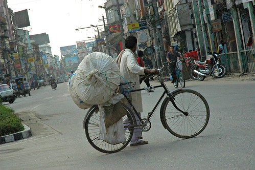 One man's personal effort against poverty, recycler on a bicycle, Kathmandu, Nepal by Wonderlane