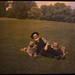 Man lying on ground with two dogs by George Eastman House