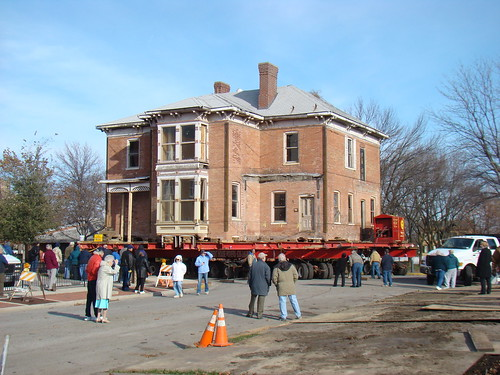 House being moved on the back of a truck