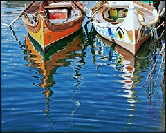 colorful boats and reflections