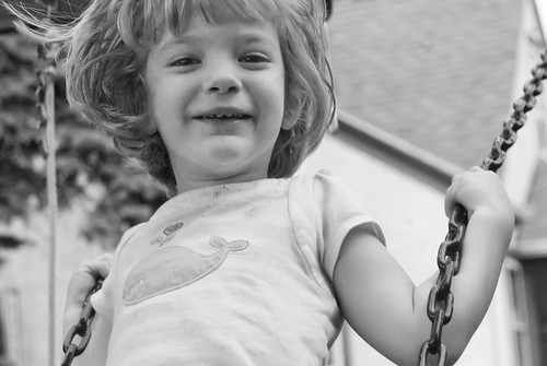 I can't decide whether this photo should be color or grayscale. It was drastically underexposed, since the camera metered off of the house behind her, so it took a lot of photoshop fun to get it to a usable state.