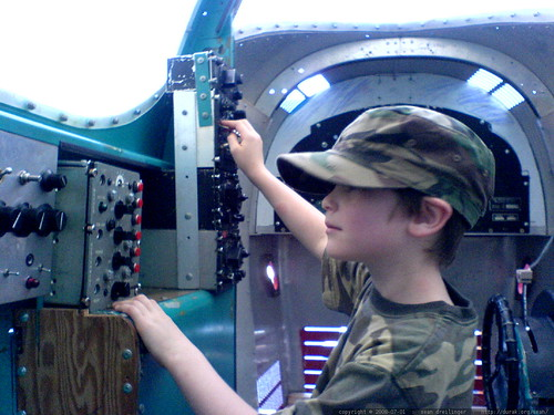 camo nick going to town in a simulated cockpit at hiller air museum   DSC01220