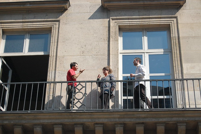 3 People In Conversation On A Balcony Flickr Photo