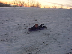 vehicle(0.0), tubing(0.0), sports(0.0), winter sport(1.0), winter(1.0), snow(1.0), ice(1.0), sledding(1.0), sled(1.0),