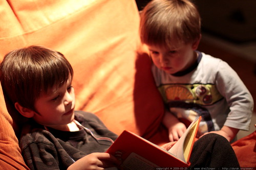 nick reading green eggs and ham to his little brother    MG 9632